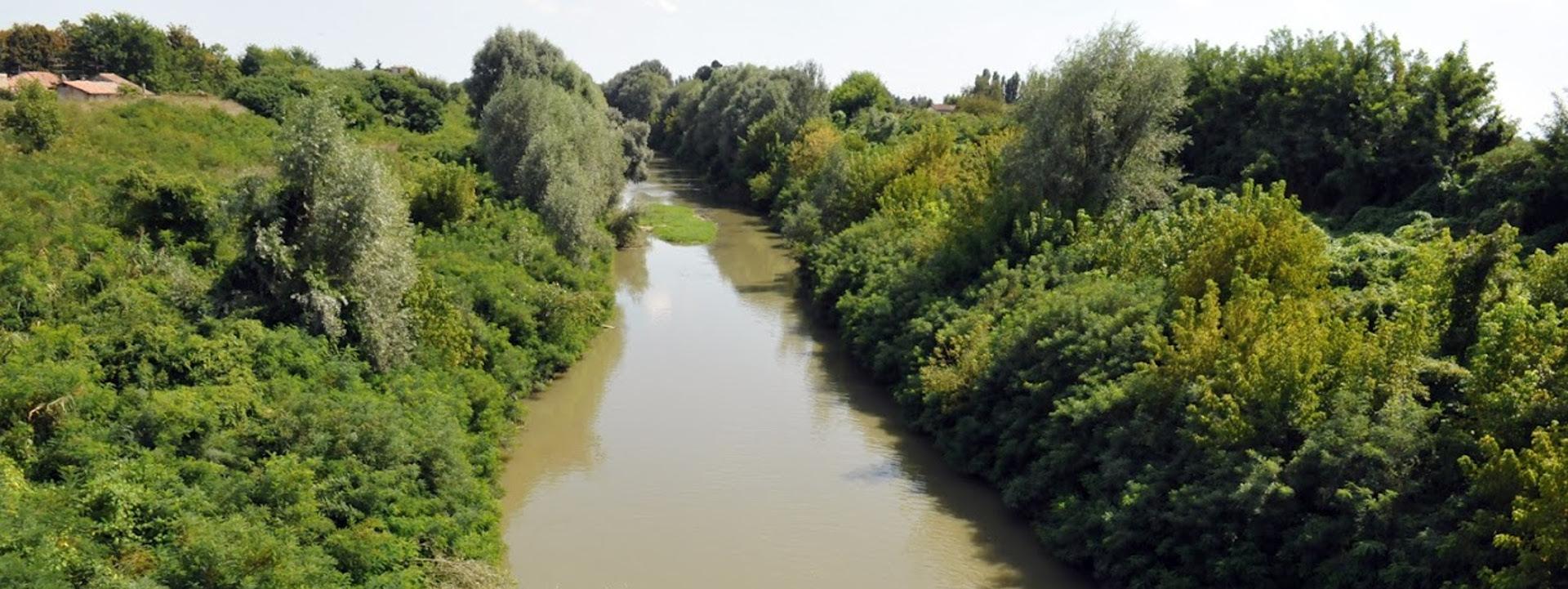 Foto: il fiume Reno che attraversa la pianura bolognese. Archivio Città metropolitana di Bologna